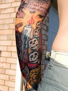 Photograph of the Mumma Coat of Arms tattooed on the leg of Craig Mumma It