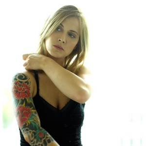 Anouk has two tattoo designs, one of which is a large sleeve from her