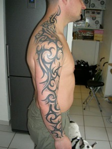 Tribal Arm Tattoos A full sleeve tattoo is one that literally covers the arm