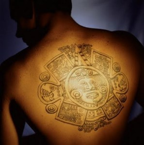 Beautiful Aztec symbol tattoo on the back.