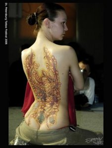 Flower Tattoo on woman back's. Posted by invador at 12:14 AM