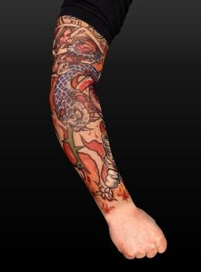 Photo of me and my work in progress, enchanted forest full sleeve tattoo.