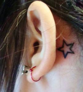 Behind ear star tattoo design